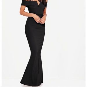 Black tight fitted off the shoulder dress